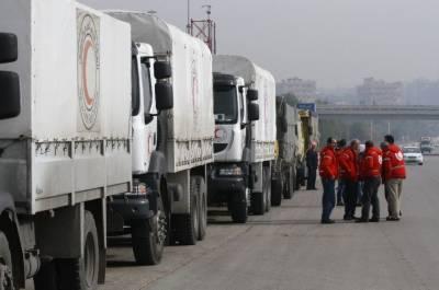 UN humanitarian aid reaches besieged Syrian towns during short ceasefire