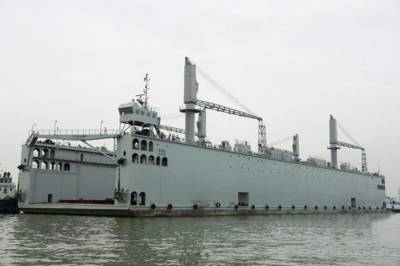 China's Navy launches first self propelled dock capable of repairing it's naval arsenal in combat zone