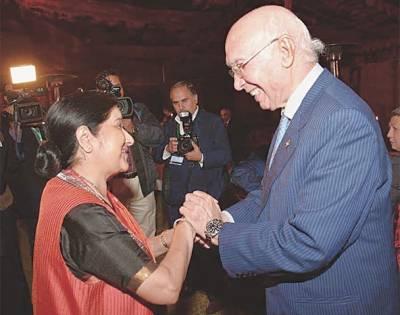 Sartaj hands over Sushma the formal invitation for PM Modi visit to Pakistan