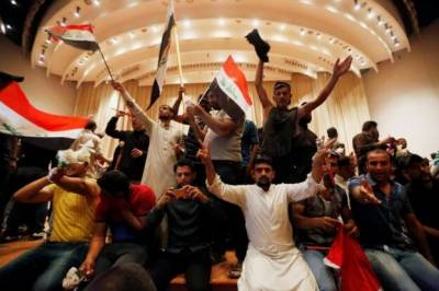 Iraqi Parliament stormed by supporters of Muqtada Al Saddar