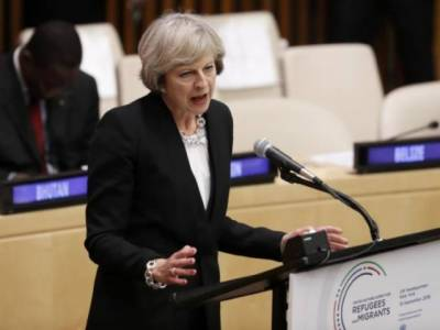 British PM calls for tougher stance on migrants in UN Refugees summit