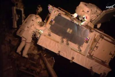 Astronauts space walk to rectify power system of International space station