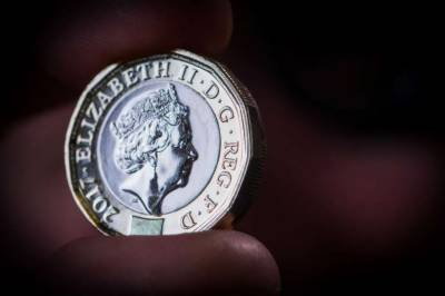 Britain's new pound coin enters circulation