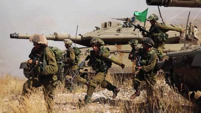 Israeli Army martyrs stone throwing Palestinians in Gaza