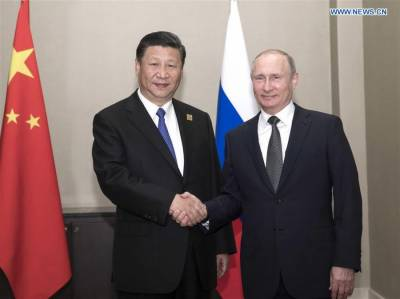 China-Russia vow for more active role in Afghanistan in Xi-Putin meeting