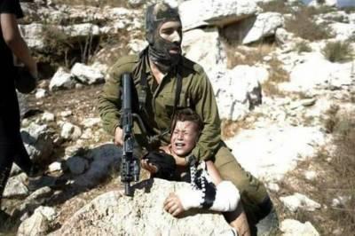 Israeli Army soldier assaults Palestinian child