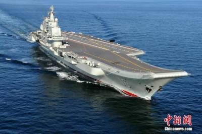 Chinese Navy Aircraft carrier maneuvering exercises in a power show