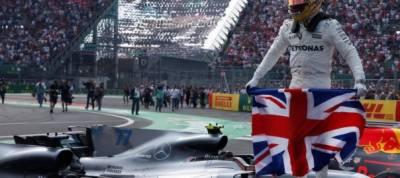 Racing: Hamilton takes fourth title despite collision