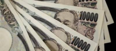 Japan's cash-rich companies ready to spend more on M&A, not wages