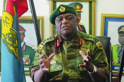 Zambabwe's Army Chief sternly warns politicians to behave