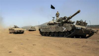 Israeli tank target Syrian military posts in Golan Heights