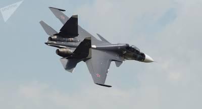 Russian Air Force Su - 30 fighter jet scrambles to intercept US reconnaissance aircraft