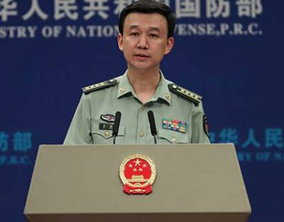 China warns intervention from outside complicates South China Sea situations