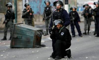 Israeli troops clash with Palestinian protesters in occupied West Bank, Gaza