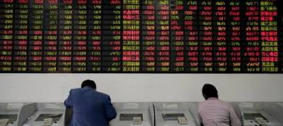 Asian shares slip, US tax reform woes dent sentiment