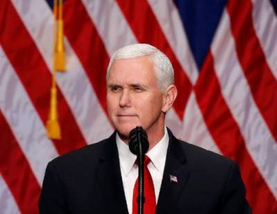 Pence delays trip to Egypt, Israel because of U.S. tax vote