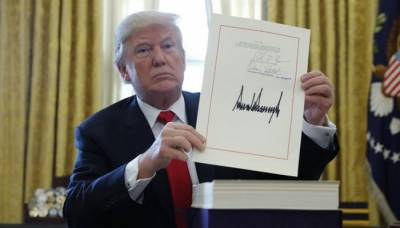 'Washington- Donald Trump signs historic tax reforms bill worth $1.5 trillion