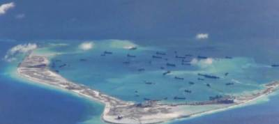 Chinese report says South China Sea islands expanded 'reasonably'