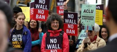 Federal judge partially lifts trump's latest refugee restrictions