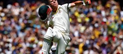 Warner grabs lucky tonne as Australia slow to 145-2