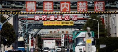 Asian factories end robust 2017 on mixed note; central banks seen hiking slowly