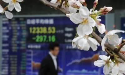 Asian shares edge up, yen jumps as BOJ trims bond buying