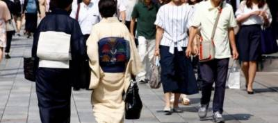 More Japan households see higher inflation, feel pinched