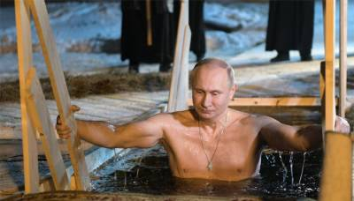 Russia's Putin takes a dip in the freezing lake to mark Orthodox Christian ritual