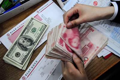 Chinese yuan rises against US Dollar