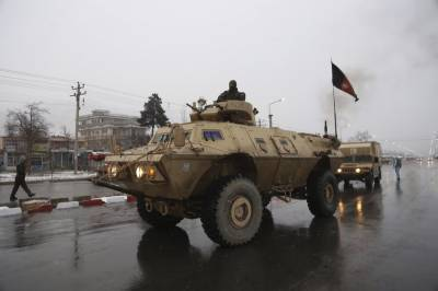 Two Afghan generals fired, to stand trial over academy assault