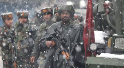Indian Force rejoice after killing two militants in a 30 hour encounter in occupied Kashmir