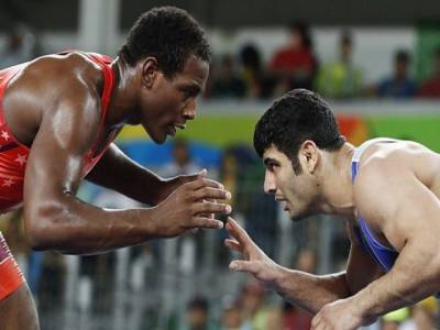Iran protests ban on wrestler who threw bout to avoid Israel