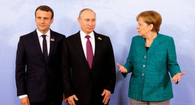 Putin discusses Syrian crisis with Macron, Merkel