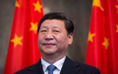 China downplays the Communist Party move to scrap presidential term limits
