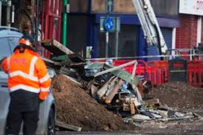 UK police charge three men over deadly explosion