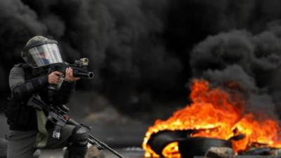 Israeli troops martyr Palestinian