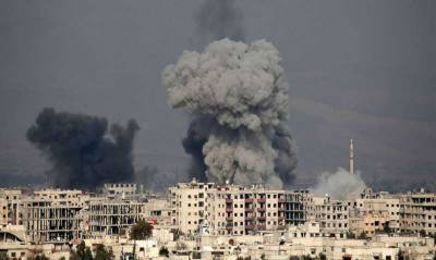 100 killed in single day in Syria: Thousands flee twin offensives in Afrin and Ghouta
