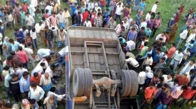 Bus falls into dry river bed in east India, killing 12