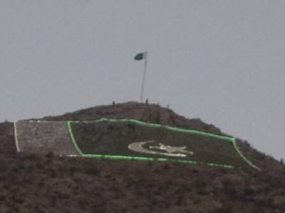 Pakistani Flag hoisted and lit at one of the highest place in Balochistan