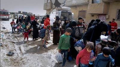 In Syria, rebel groups pull out of more towns in Eastern Ghouta