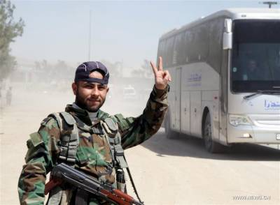 Over 13,000 rebels, families leave Syria's Eastern Ghouta in 3 days