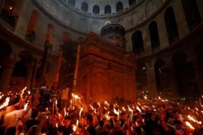 Christian pilgrims hold Holy fire at Jerusalem holy site