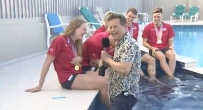 (VIDEO) BBC Jounalist falls into swimming pool during live interview