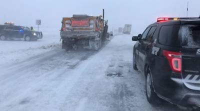 Storm system blasts central US
