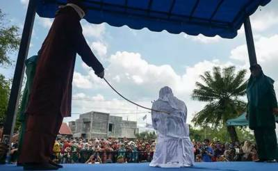 Couple and alleged sex workers publicly whipped in this Islamic country