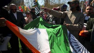 Indian flag torn by angry protesters in London