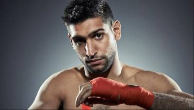 Amir Khan vows to return with electrifying performance