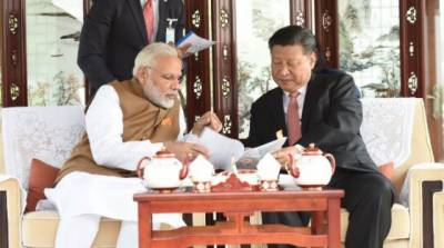 China's Xi, India's Modi seek new relationship after summit