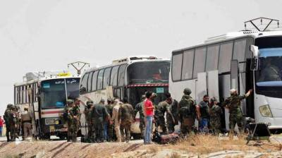 Syrian rebels start pull-out from south Damascus