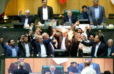 US flag burnt in Iranian Parliament among